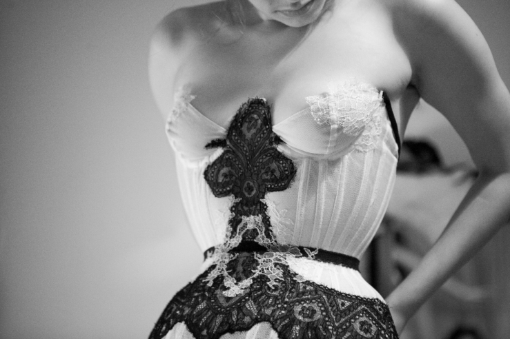 Cupped bobbinet corset overlaid with carefully cut and hand stitched Victorian lace appliqué. Design by Karolina