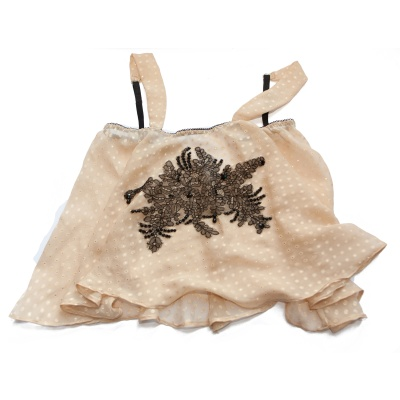 A one off silk camisole embellished with hand-stitched Victorian lace. Design by Karolina Laskowska
