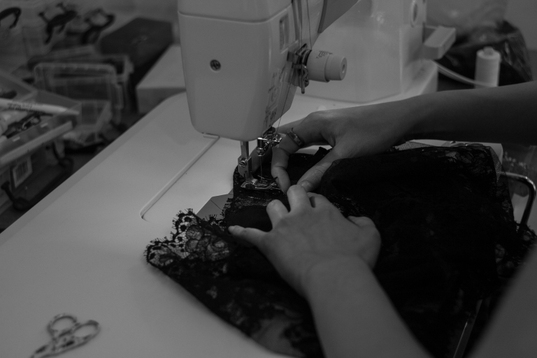 Stitching some glorious French lace knickers in my studio this Summer. Photo by A. Lindseth
